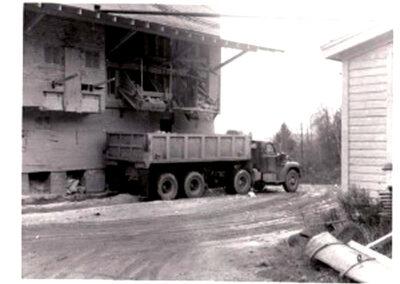 09 loading ore truck at mine bins